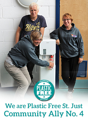 Plastic Free St. Just awarded GO St. Just 'Plastic Free Champion' status. Pic shows 3 m3mbers of staff using the new water dispenser that replaces platic bottles of water.