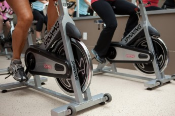 2 people exercising on Spinning bikes